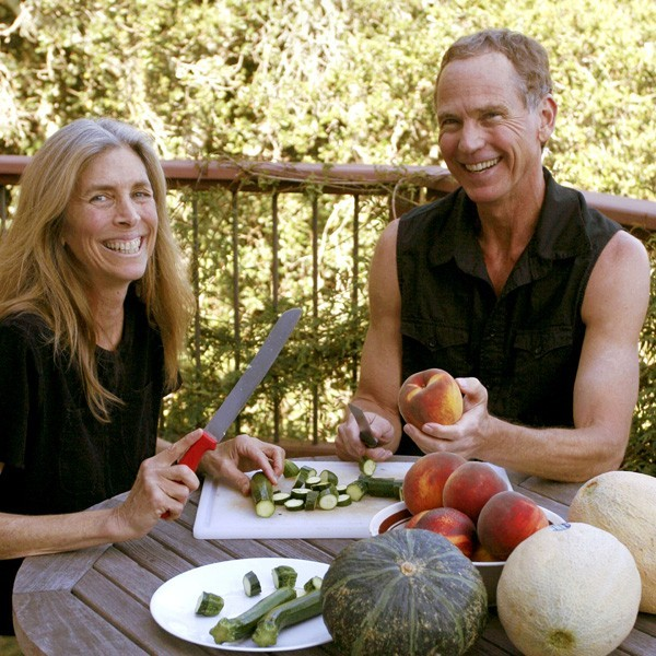 John and his wife Deo preparing a meal.